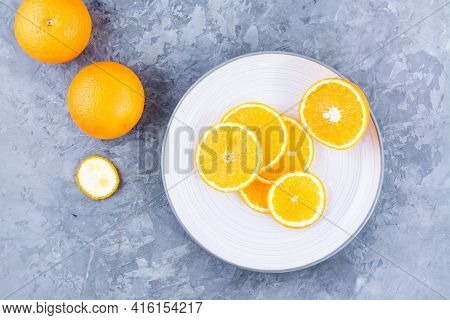 Pieces Of Fresh Orange On A Plate On The Table. Vitamins, Diet And Vigor. Healthy Eating. Top View