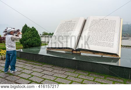 Three Gorges Dam, China - May 6, 2010: Yangtze River. Giant Book Statue With Explanatory Text About