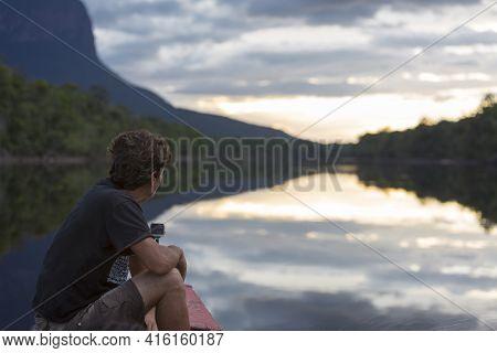 Canaima National Park, Venezuela, April 11: Man Looking At The Sunset On The Gauja River. Canaima Na