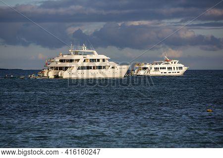 Puerto Ayora, Ecuador, February 12: Sunset And Cruise Ships In The Port Of Puerto Ayora. Galapagos I