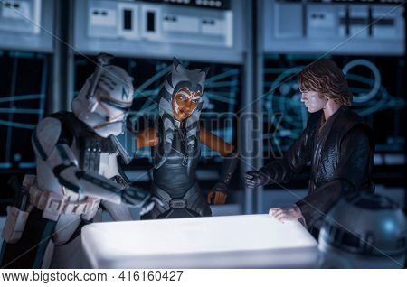 APRIL 8 2021: Scene from Star Wars the Clone Wars, Anakin Skywalker, Ahsoka Tano and Captain Rex view battle plans  - Hasbro action figure