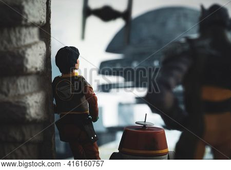 APRIL 8 2021: Scene from Star Wars Rebels with Ezra Bridger, Zeb and droid Chopper spying on the Imperial complex  - Hasbro action figure