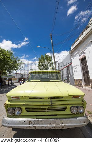 Salta, Argentina, December19: Vintage Green Chevrolet In The Street Of Salta With A Clear Blue Sky,
