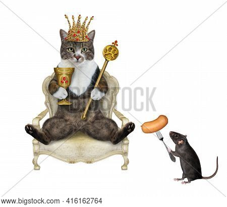 A Colored Cat In A Gold Crown Holds A Scepter And A Goblet In A Throne. White Background. Isolated.