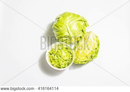 Fresh Young Shredded Cabbage, Whole Head And Cut Piece Isolated In White Background