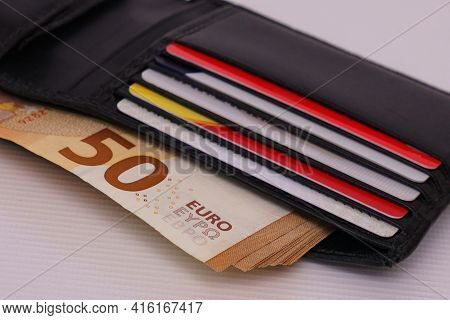 Open Leather Wallet With Cards And Fifty Euro Bills. Close Up.