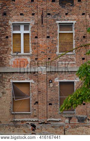 Abandoned House With Brick Facades And Closed Windows. Casalmaggiore, Lombardia, Italia
