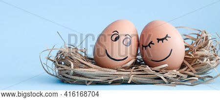 Happy Eggs. Brown Eggs Draw A Sweet Smile And Draw A Happy Face. Blue Background. The Concept Of A H