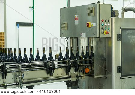 Wine Production Machine, Filling The Bottles. Industrial Product