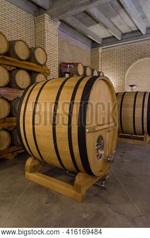 Oak Barrels For Wine Aging In An Underground Cellar In Vale Dos