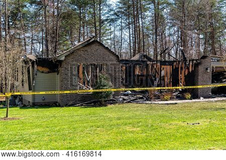 Remains Of A Fire Damaged Single Family Home