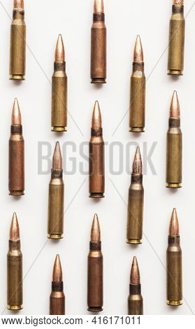 A Group Of Bullet Ammunition Shells On A White Background