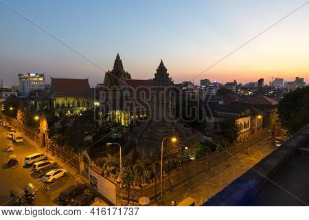 Phnom Penh, Cambodia - 28/01/2016: Night View Of Phnom Penh With Street And Car Lights Next To The M