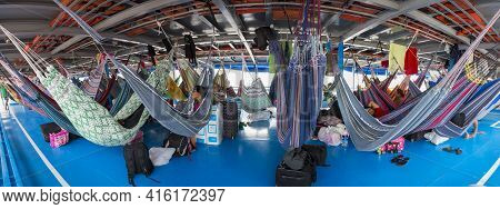 Amazon, Brazil - March 18: Panorama Of People Resting In Hammocks On Passenger Boat Deck Going Down