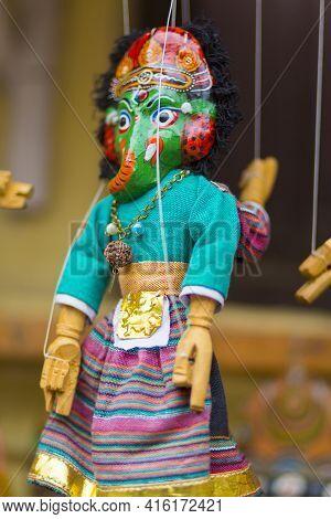 Kathmandu, Nepal, April 21: Blue Green Ganesha Toy Hanging On A String In Art And Craft Market In Ka
