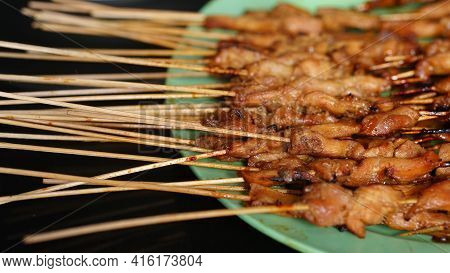 Lots Of Chicken Satay On The Plate. Indonesian Special Food. Focus Selected