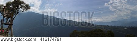 Banos, Ecuador, February 21: Panoramic View Of Mountain With La Casa Del Arbol And A Group Of Touris