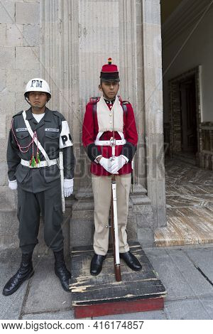 La Paz, Bolivia, January 3: Military Police And Traditional Security Guard Standing At The Entrance