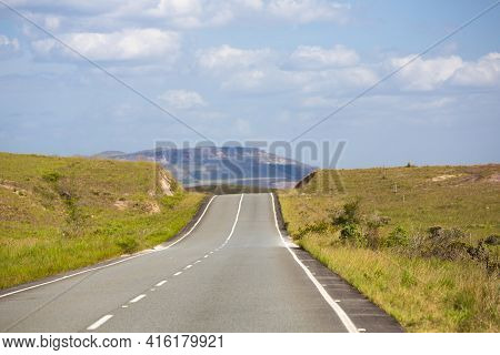 Straight Inspiring And Typical Road Close To Mount Roraima In Gran Sabana, Blue Sky With Clouds In T