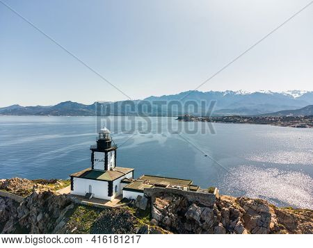 Aerial View Of Revellata Lighthouse On A Rocky Outcrop Near Calvi In The Balagne Region Of Corsica W