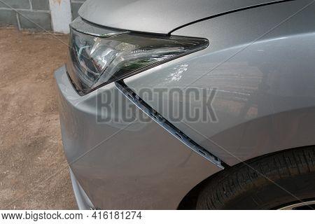 Car Crash Or Accident. Front Fender And Light Damage On Bumper. Broken Vehicle Detail Of Private Car