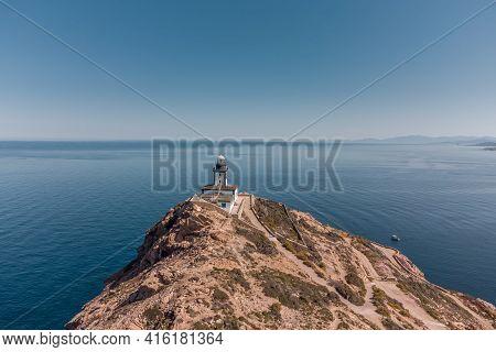 Revellata Lighthouse On A Rocky Outcrop Near Calvi In The Balagne Region Of Corsica With Cap Corse I