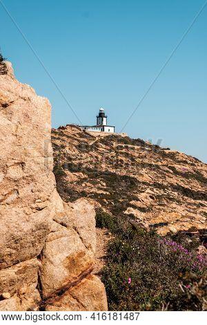 Revellata Lighthouse On A Rocky Outcrop Near Calvi In The Balagne Region Of Corsica