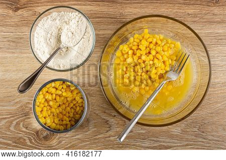 Cooking Corn Pancakes. Spoon In Bowl With Flour, Jar Of Sweet Corn, Fork In Transparent Bowl With Mi
