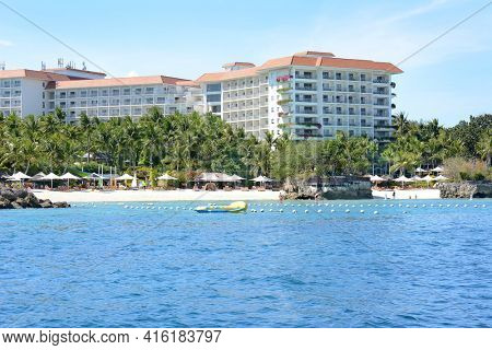 CEBU, PHILIPPINES - APRIL 5, 2016: Shangri La Mactan Resort and Spa from the water. The luxury resort features a Marine Sanctuary.
