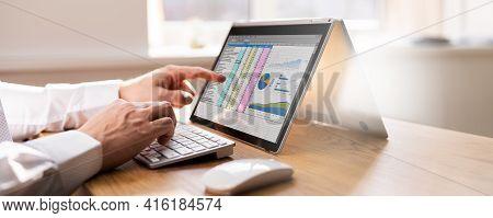 Spreadsheet Business Data Analyst Using Computer Screen