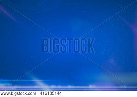 Futuristic anamorphic lens flare on deep blue background