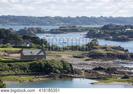 Houses And Small Boats On Brehat Island In Brittany. Cotes D'armor During A Sunny Day. France