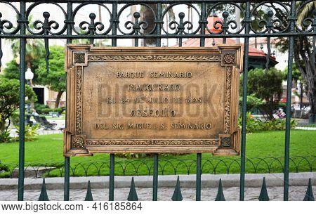 GUAYAQUIL, ECUADOR - FEBRUARY 15, 2017: Seminario Park Dedication Sign. Seminario Park is also known as the Iguana Park, since dozens of iguanas live in its ornate gardens.