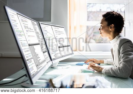 African American Programmer Woman Coding On Computer