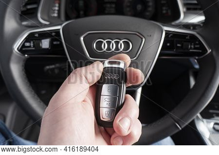 Sankt-petersburg, Russia, March 25, 2021: Close Up Of Audi A6 Car Keys In Driver Hand. Black Leather