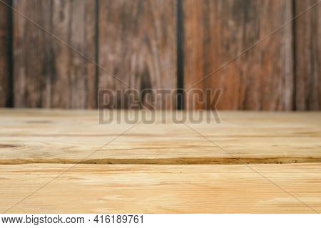 Wooden Board Empty Table Top On Of Blurred Background. Perspective Brown Wood Table Over Blur, Close