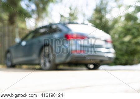Blurred Car With Bokeh Lights Background. Abstract Blur Outdoor Car For Background. Blurred Car Exte
