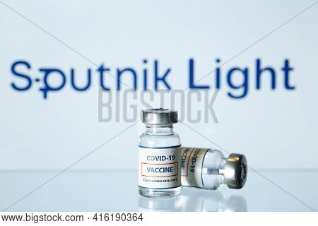 Concept Of Russian Vaccine Against Covid-19. Glass Medical Vials With Liquid. Ampoules With Coronavi
