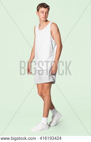 Men's white tank top and gray shorts for youth summer apparel shoot with design space