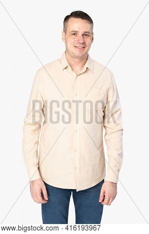 Man wearing beige long-sleeve shirt
