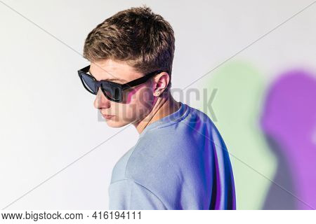 Guy with white sunglasses for fashion photoshoot