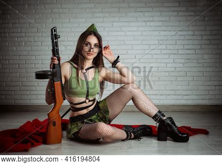 Woman In A Sexy Soviet Military Uniform With A Ppsh-41 Submachine Gun In A Short Skirt And Leather B