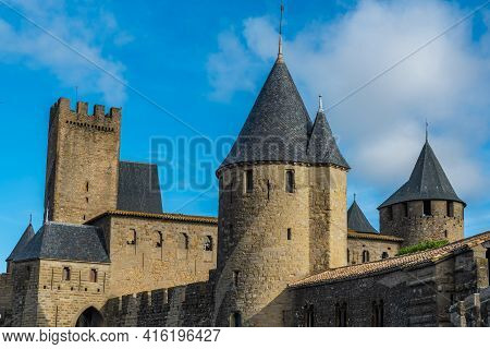 View Over The Historical Castle Carcassone - Cite De Carcassone - With The Towers, Background Blue S