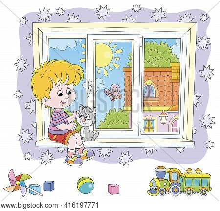 Little Boy Playing With His Cute Small Kitten On A Windowsill In A Nursery Room With Starry Wallpape