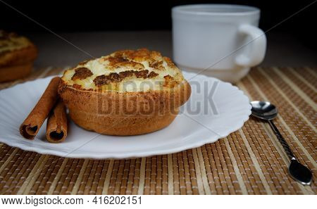 Muffin With Cottage Cheese And Cinnamon On A White Plate. Cinnamon Sticks. . Muffin Close Up.