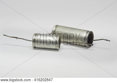 Capacitors Metal-paper With Black Flat Ends. Pair Of Vintage Electronic Parts Of Circuit Of Tube Sou