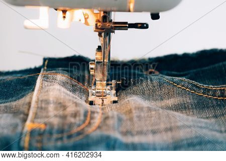 Modern Sewing Machine For Repairing Or Sewing Clothes Denim Sewing Process. Sewing Equipment Selecti