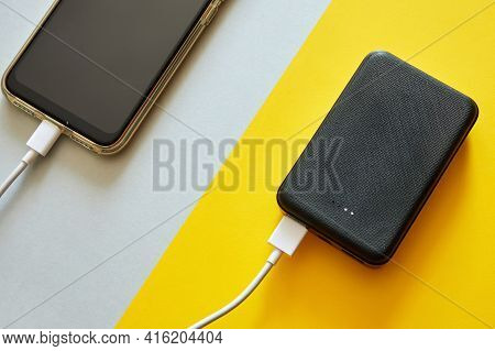 Power Bank Charges Smartphone Using A Usb Cable