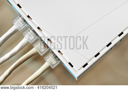 Ethernet Cables Connected To Desktop Switch Or Routerboard. Close-up, Selective Focus