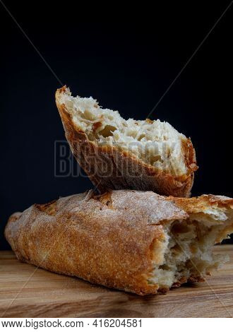 Broken In Half Baguette. Beautiful Bread Close-up. Art Bread.